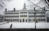 A jogger runs by Dartmouth Hall the original Dartmouth College building which was built in 1784 and then rebuilt after a fire in 1904 at Dartmouth...