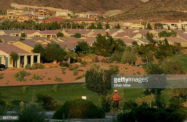 A jogger runs by homes in the MacDonald Highlands community on the southern end of Henderson on June 30 2005 in Henderson Nevada Henderson a suburb...