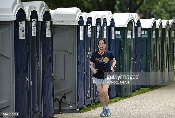 A jogger runs by rows of portable toilets on July 1 near the Washington Monument on the Mall a popular spot to watch the Independence Day holiday...