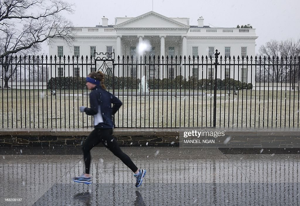 A jogger runs by the White House in snowfall on March 6, 2013 in Washington, DC. A winter storm warning remains in effect until early Thursday. A massive winter storm pounding the northern United States Tuesday grounded 2,600 flights, closed hundreds of schools and made roadways and highways impassible. At least four people were reportedly killed in accidents on icy and snow covered roads and highways. More than a dozen states from Minnesota to Virginia were in the path of the huge storm, which had already dumped as much as two feet (60 centimeters) of snow in Montana and 15 inches (38 centimeters) in North Dakota. Mandel NGAN
