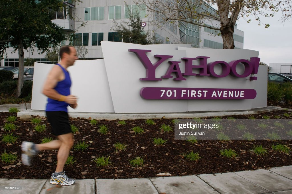 A jogger runs by the Yahoo logo on a sign outside of the Yahoo Sunnyvale campus January 22, 2008 in Sunnyvale, California. Yahoo is poised to lay off hundreds of employees in hopes of increasing profits and boosting its stock price. No date is set for the layoffs but it is likely that the notice will come around January 29th when the company reports quarterly earnings.