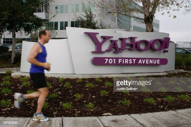 A jogger runs by the Yahoo logo on a sign outside of the Yahoo Sunnyvale campus January 22 2008 in Sunnyvale California Yahoo is poised to lay off...
