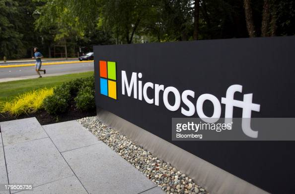 A jogger runs past signage displayed at the Microsoft Corp campus in Redmond Washington US on Wednesday Sept 4 2013 Microsoft Corp agreed to buy...