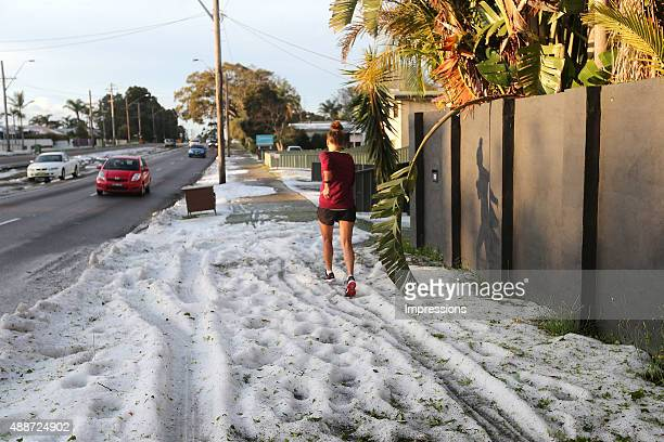 A jogger runs through the hail at Bateau Bay on September 17 2015 in Gosford Australia Hail and heavy rain swept across the region this afternoon...