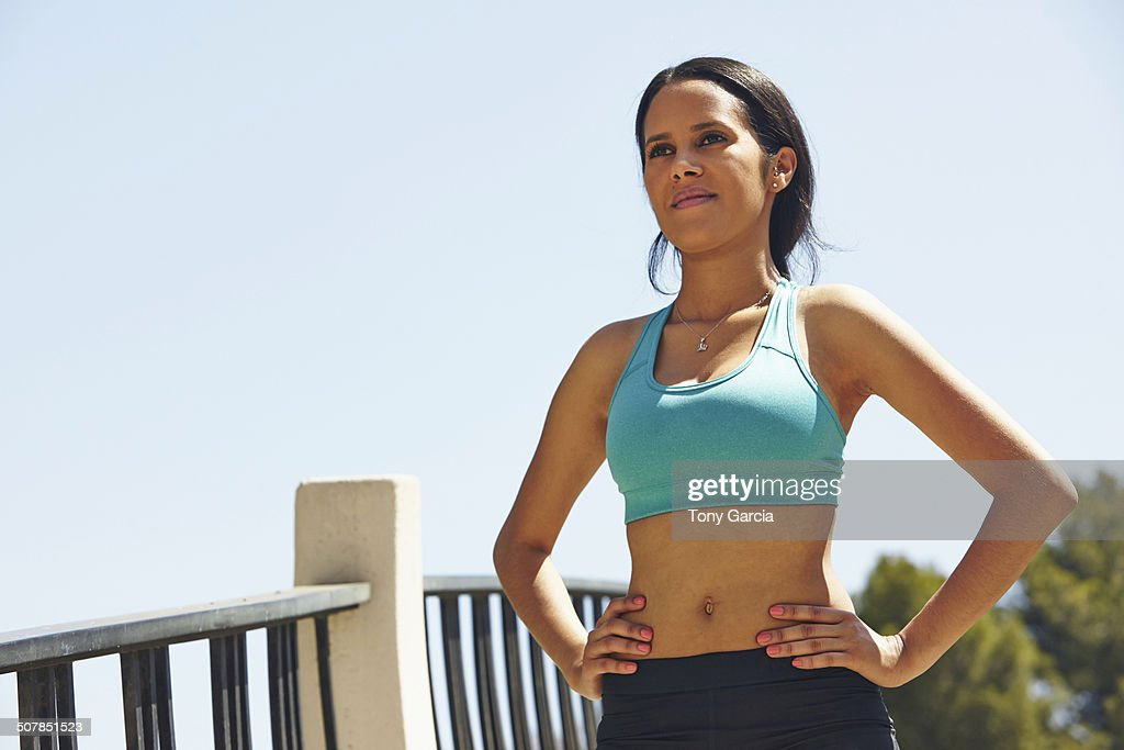 Jogger standing with hands on waist