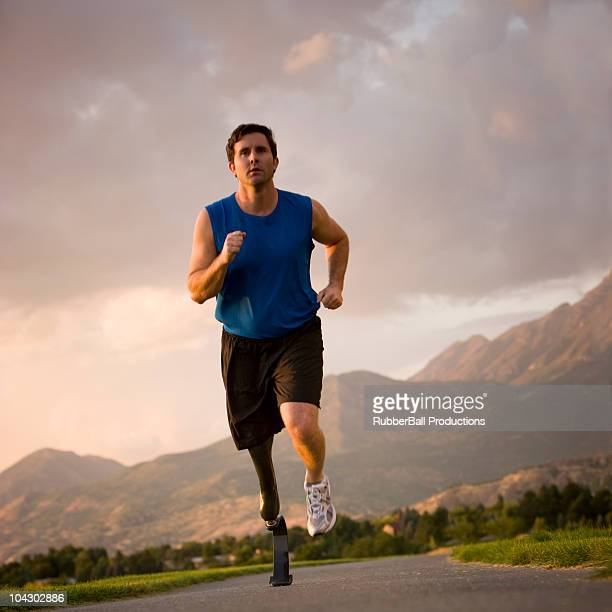 jogger with a right below knee prosthetic running leg