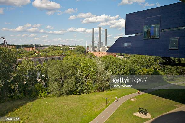 Joggers in Gold Medal Park, with view of Jean Nouvel's Endless Bridge, Minneapolis, Minnesota, Midwest, USA