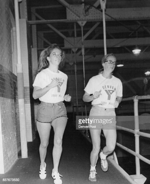 Joggers Log More than 1000 Miles at Denver YMCA Judy Miner left and Mrs Mary Painter jog around carpeted track at Downtown Y Below they do a series...
