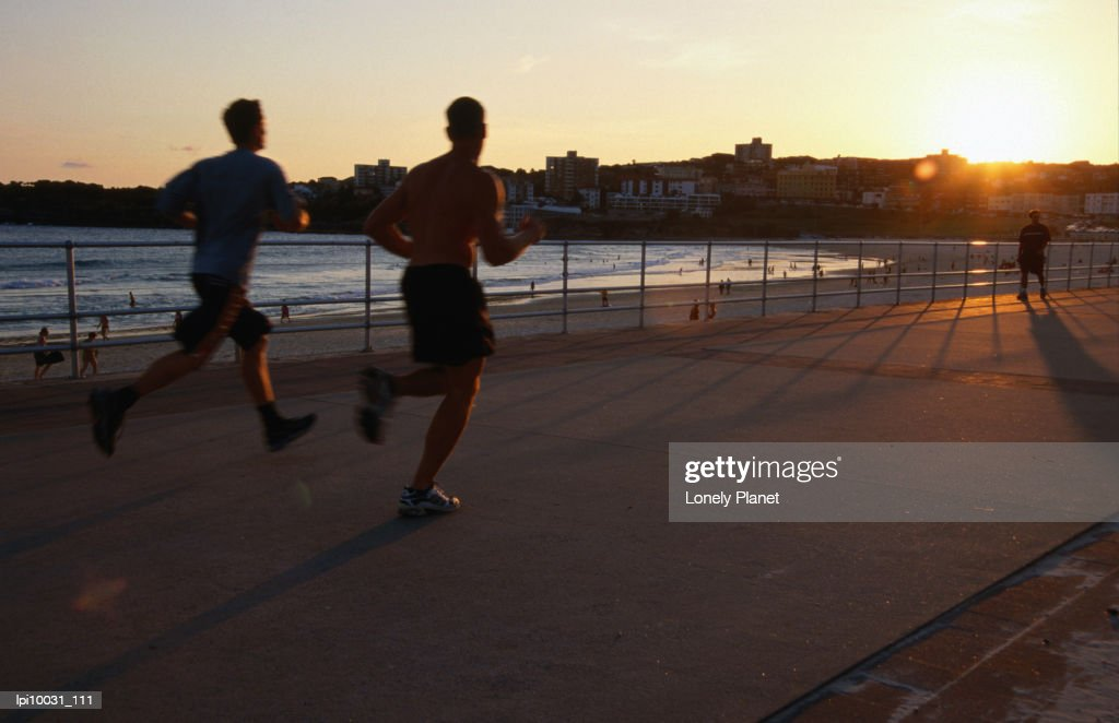 Joggers on promenade at Bondi Beach. : Stock Photo
