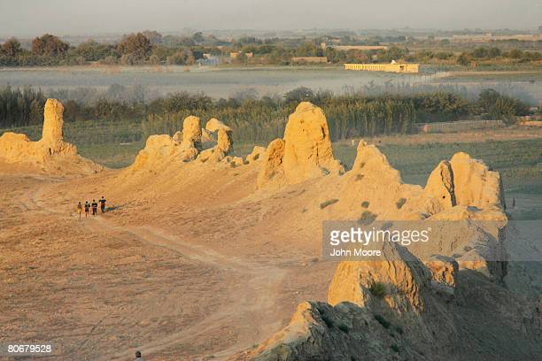 Joggers run along an ancient wall of the ancient Bala Hizar fortress of Balkh on October 12 in Afghanistan The French Archaeological Delegation to...