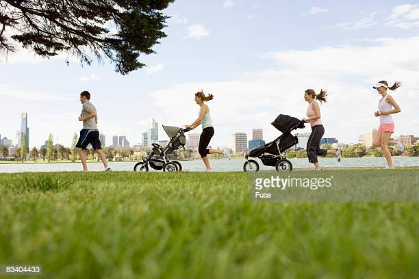 Joggers Running in Park