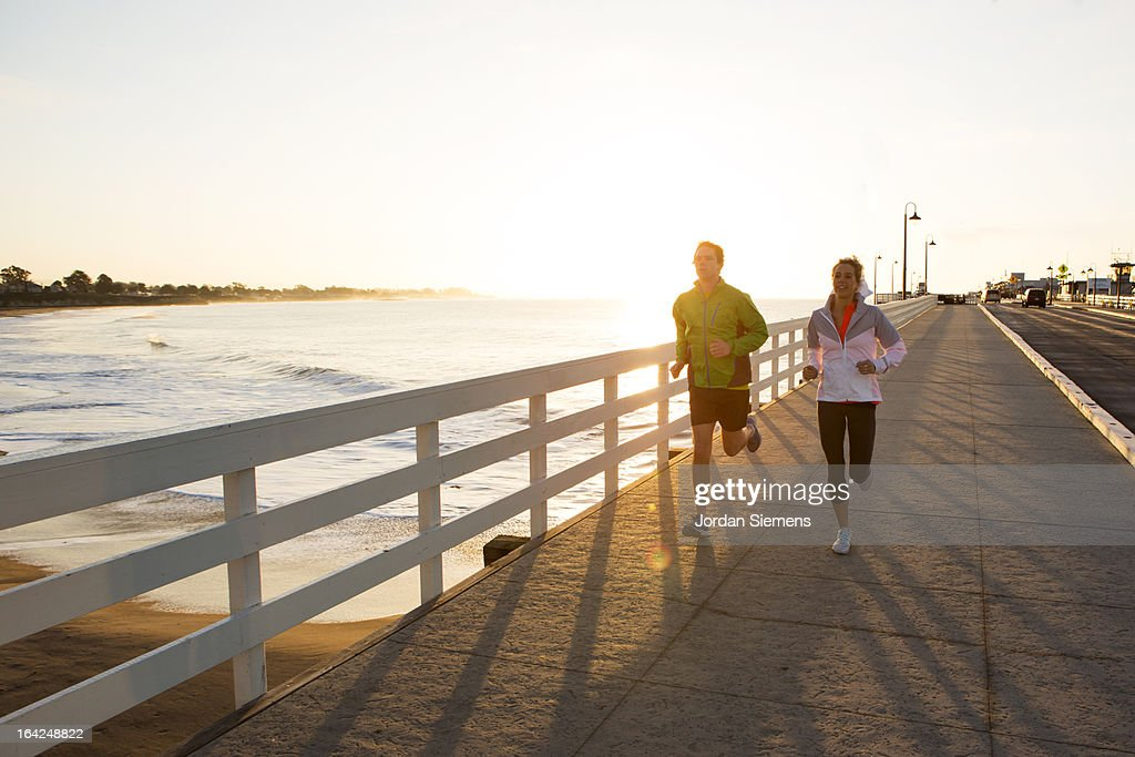 Jogging along the coast. : Stock Photo