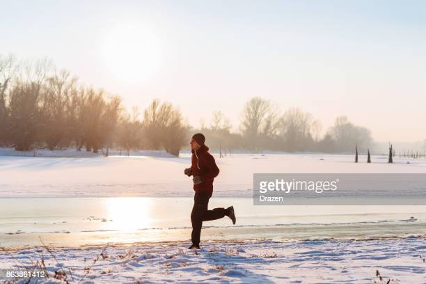 Jogging on cold winter day outdoors
