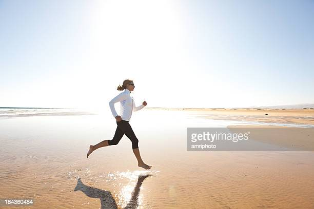 jogging on wide sandy beach