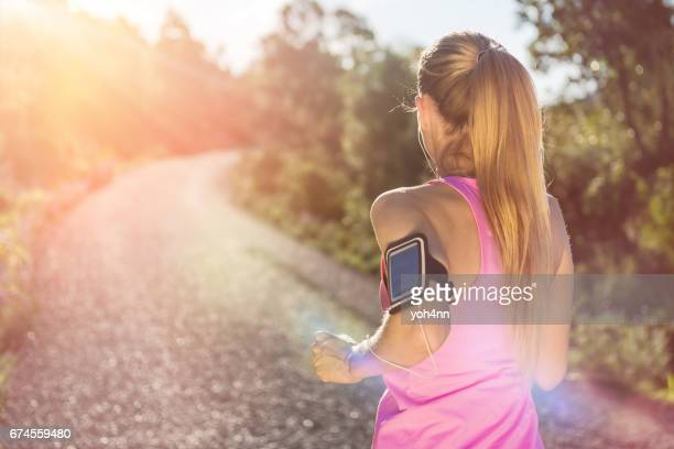 Jogging outside with audio equipment
