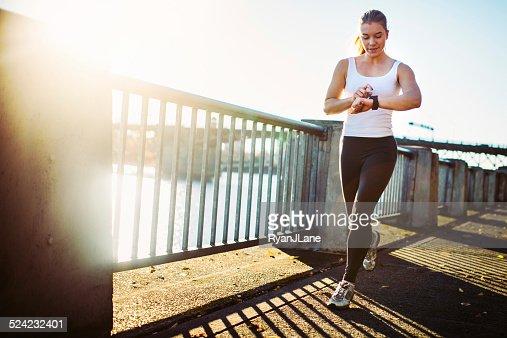 Jogging Woman Checks Smart Watch