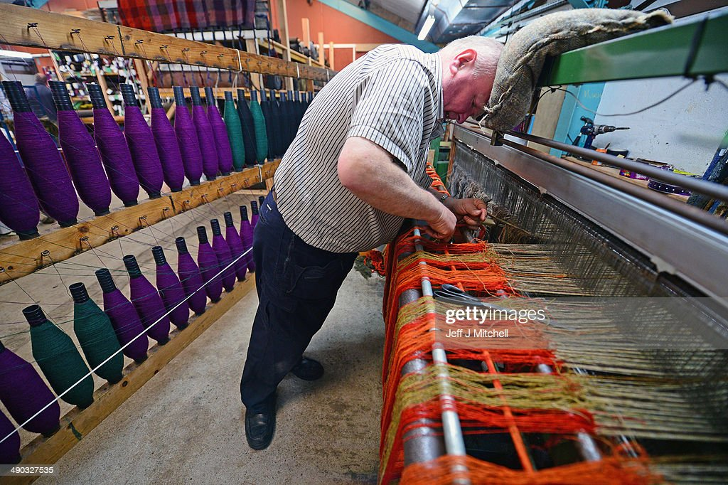 Joh Murdo Macdonald tying in a double width loom at the Harris Tweed Hebrides Company in Shawbost on May 13, 2014 in Stornoway, Scotland. Sales in one of Scotlands last cottage industries are soaring with Japan, Russia and Germany being some of the largest international importers of the cloth.