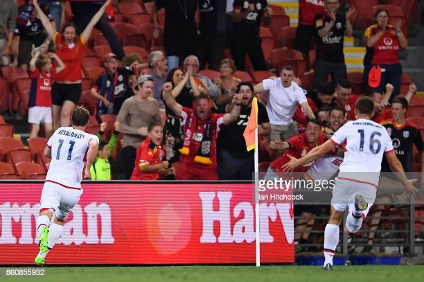 Johan Absalonsen of Adelaide United celebrates after scoring the winning goal during the round two ALeague match between the Brisbane Roar and...