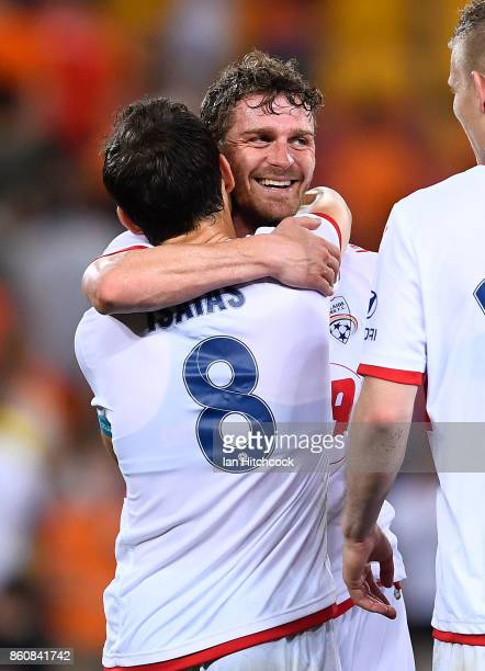 Johan Absalonsen of Adelaide United celebrates with Isaias of Adelaide United after winning the round two ALeague match between the Brisbane Roar and...