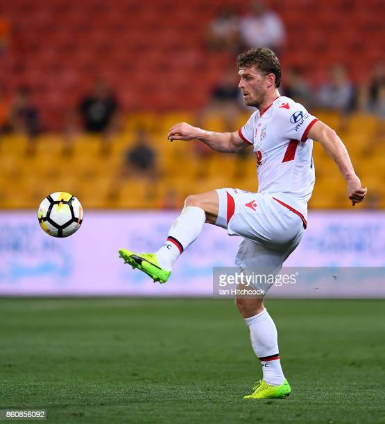 Johan Absalonsen of Adelaide United kicks the ball during the round two ALeague match between the Brisbane Roar and Adelaide United at Suncorp...