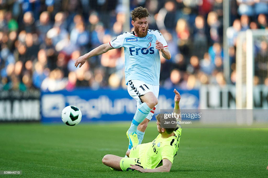 Johan Absalonsen of SonderjyskE and Jeppe Brinch of Esbjerg fB compete for the ball during the Danish Alka Superliga match between SonderjyskE and Esbjerg fB at Sydbank Park on May 06, 2016 in Haderslev, Denmark.
