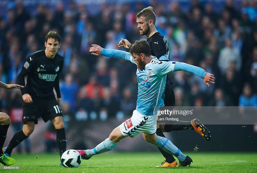 Johan Absalonsen of Sonderjyske and Mads Fenger of Randers FC compete for the ball during the Danish Alka Superliga match between Sonderjyske and Randers FC at Sydbank Park on May 26, 2016 in Haderslev, Denmark.