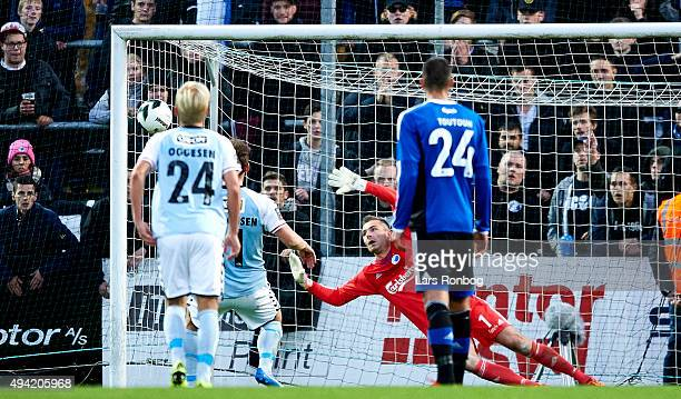 Johan Absalonsen of Sonderjyske scores the 10 goal n Goalkeeper Stephan Andersen of FC Copenhagen during the Danish Alka Superliga match between...