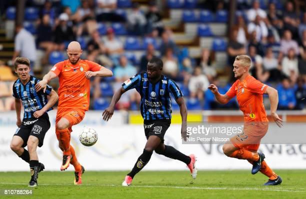 Johan Andersson of IK Sirius FK Zourab Tsiskaridze of Athletic FC Eskilstuna Moses Ogbu of IK Sirius FK and Alexander Michel of Athletic FC...