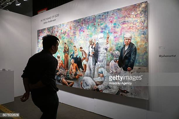 Johan Andersson's 'In the Name of God' painting is displayed at the Los Angeles Art Show at the Convention Center in downtown Los Angeles California...