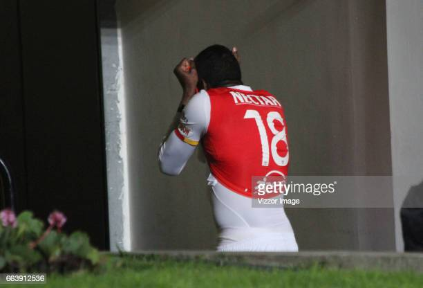 Johan Arango of Independiente Santa Fe leaves the field after being expelled during a match between Independiente Santa Fe and Independiente Medellin...