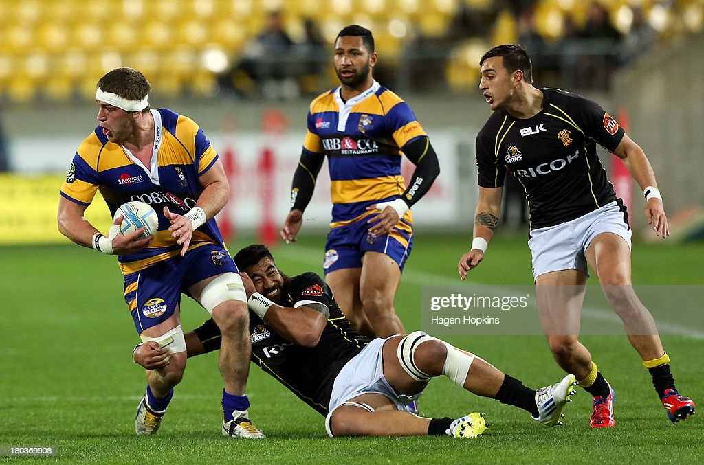 Johan Bardoul of Bay of Plenty is tackled by Genesis Mamea of Wellington during the round 5 ITM Cup match between Wellington and the Bay of Plenty at Westpac Stadium on September 12, 2013 in Wellington, New Zealand.