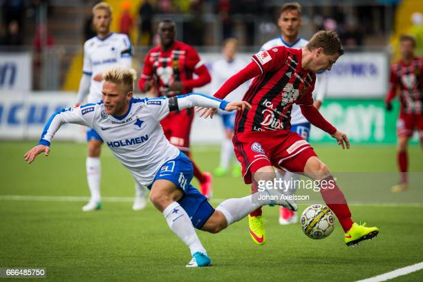 Johan Bertilsson of Ostersunds FK and Nicklas Barkroth of IFK Norrkoping competes for the ball during the Allsvenskan match between Ostersunds FK and...