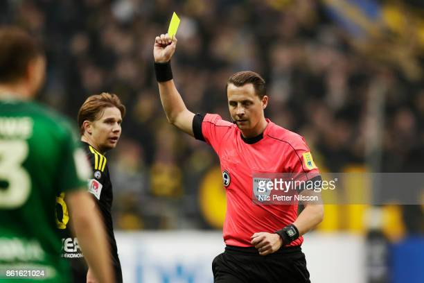 Johan Blomberg of AIK is being shown a yellow card by Andreas Ekberg referee during the Allsvenskan match between AIK and Jonkopings Sodra IF at...