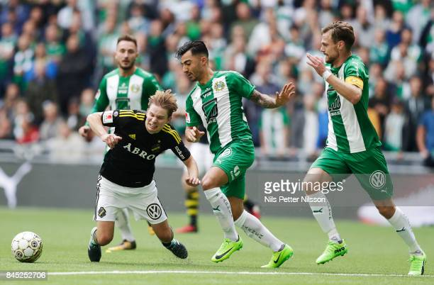 Johan Blomberg of AIK is fouled by Jiloan Hamad of Hammarby IF during the Allsvenskan match between Hammarby IF and AIK at Tele2 Arena on September...