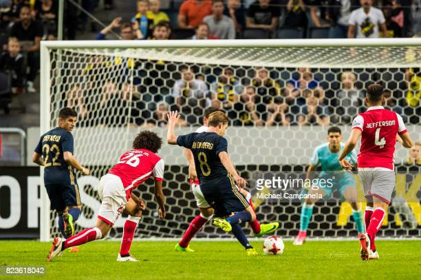 Johan Blomberg of AIK takes a shot at goal during a UEFA Europa League qualification match between AIK and SC Braga at Friends arena on July 27 2017...