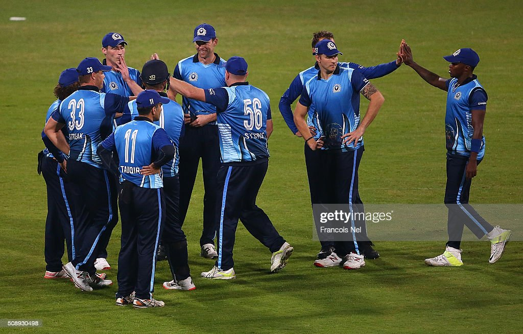 Johan Botha of Leo Lions celebrates the wicket of Jacques Kallis of Libra Legends with his team-mates during the Oxigen Masters Champions League match between the Libra Legends and Leo Lions on February 7, 2016 in Sharjah, United Arab Emirates.