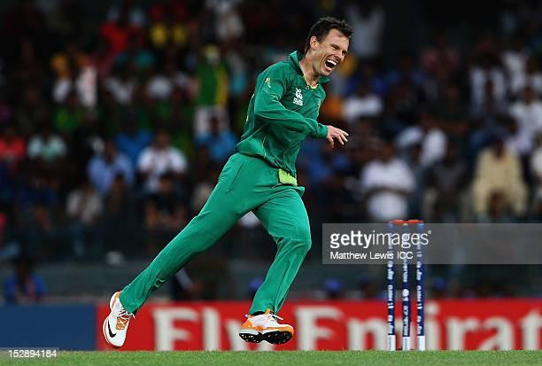 Johan Botha of South Africa celebrates bowling Kamran Akmal of Pakistan during the ICC World Twenty20 2012 Super Eights Group 2 match between...