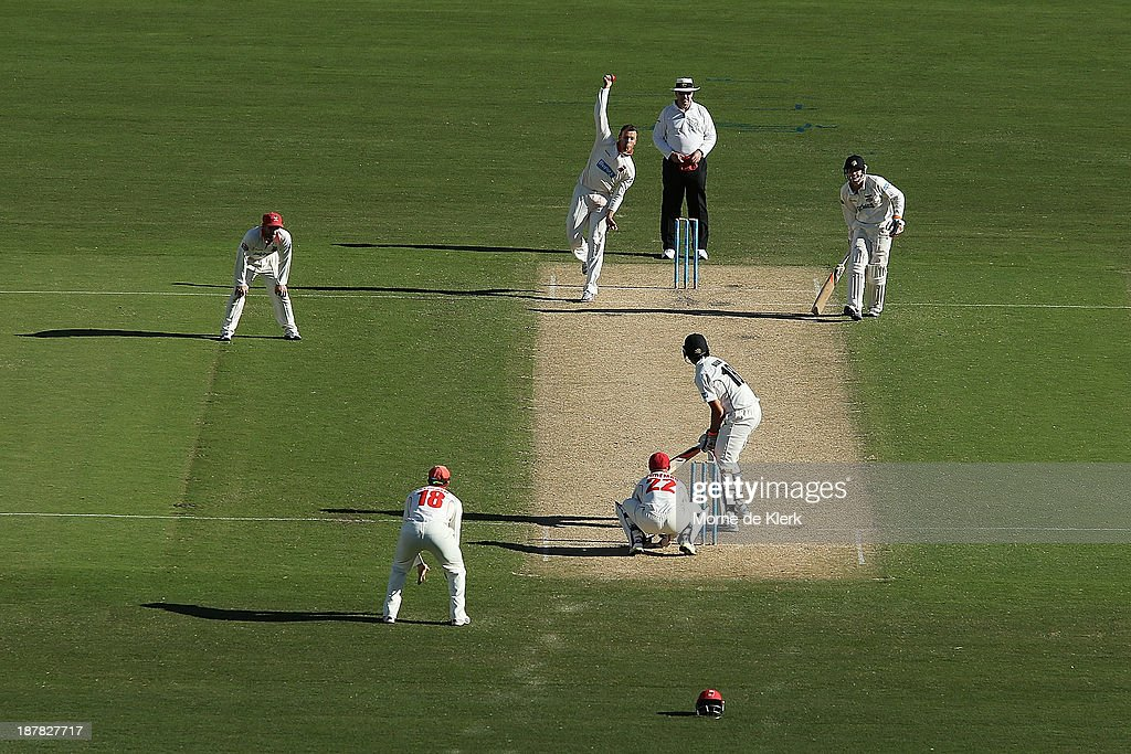 Johan Botha of the Redbacks bowls during day one of the Sheffield Shield match between the Redbacks and the Warriors at Adelaide Oval on November 13, 2013 in Adelaide, Australia.