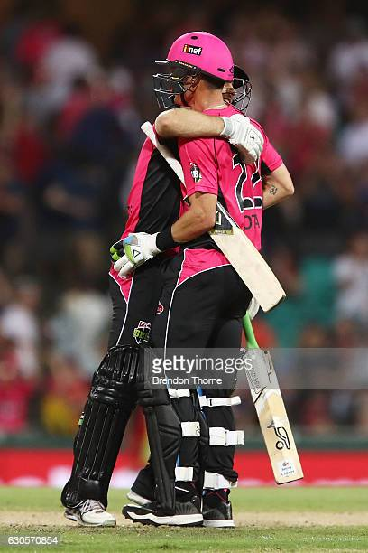 Johan Botha of the Sixers celebrates with team mate Ryan Carters after hitting the winning runs during the Big Bash League match between the Sydney...