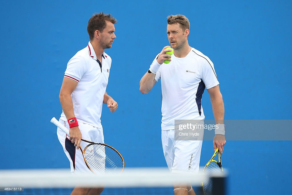 Johan Brunstrom of Sweden and Frederik Nielsen of Denmark in action in their second round doubles match against Julien Benneteau of France and...