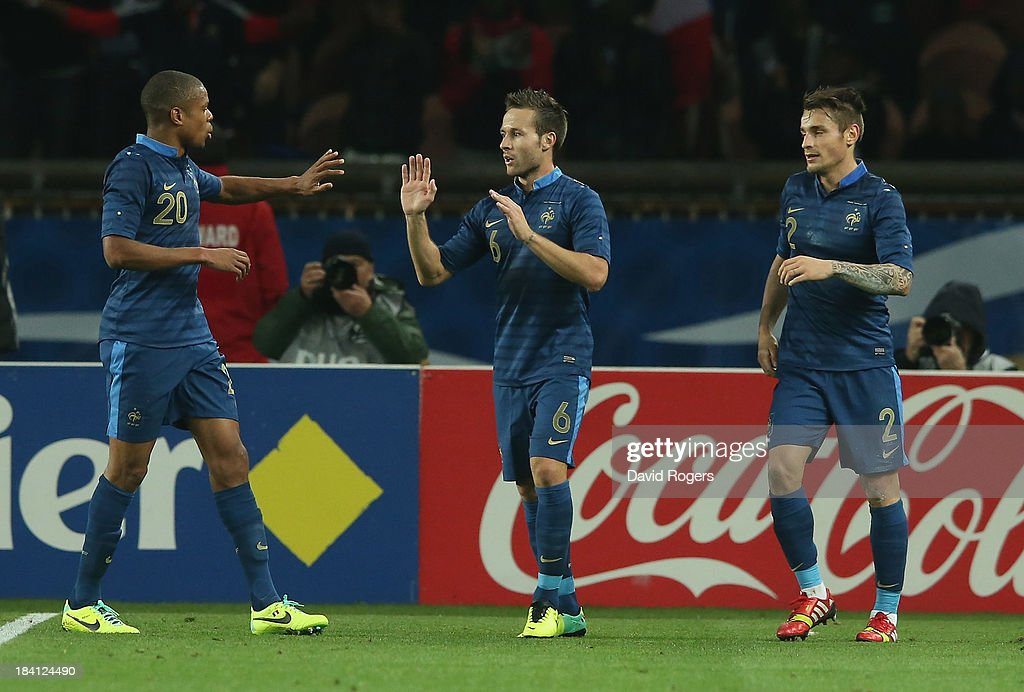 Johan Cabaye of France celebrates with team mates Loic Remy (L) and Mathieu Debuchy after scoring a goal during the International Friendly match between France and Australia at Parc des Princes on October 11, 2013 in Paris, France.