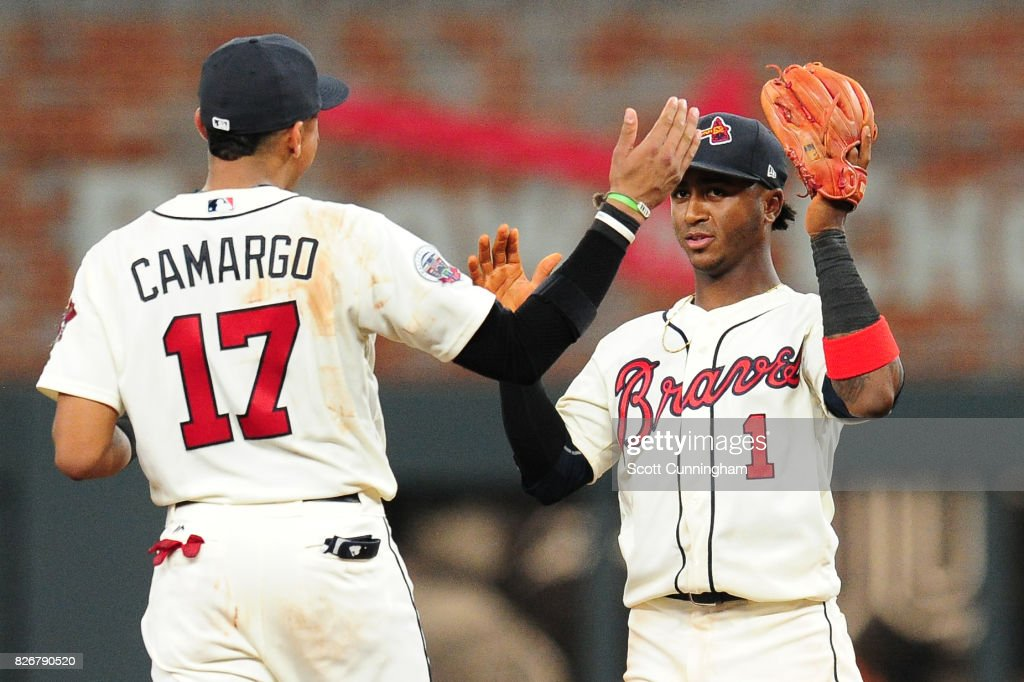 Johan Camargo #17 and Ozzie Albies #1 of the Atlanta Braves celebrate after the game against the Miami Marlins at SunTrust Park on August 5, 2017 in Atlanta, Georgia.