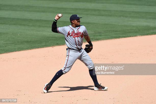 Johan Camargo of the Atlanta Braves throws the ball during the game against the Los Angeles Dodgers at Dodger Stadium on July 23 2017 in Los Angeles...