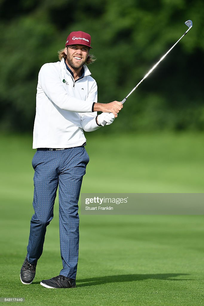 Johan Carlsson of Sweden hits an approach shot during the rain delayed third round of the BMW International Open at Gut Larchenhof on June 26, 2016 in Cologne, Germany.