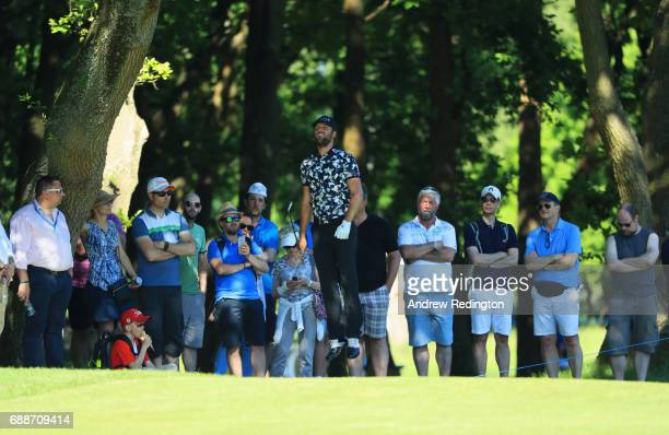 Johan Carlsson of Sweden jumps to watch his second shot on the 6th hole during day two of the BMW PGA Championship at Wentworth on May 26 2017 in...
