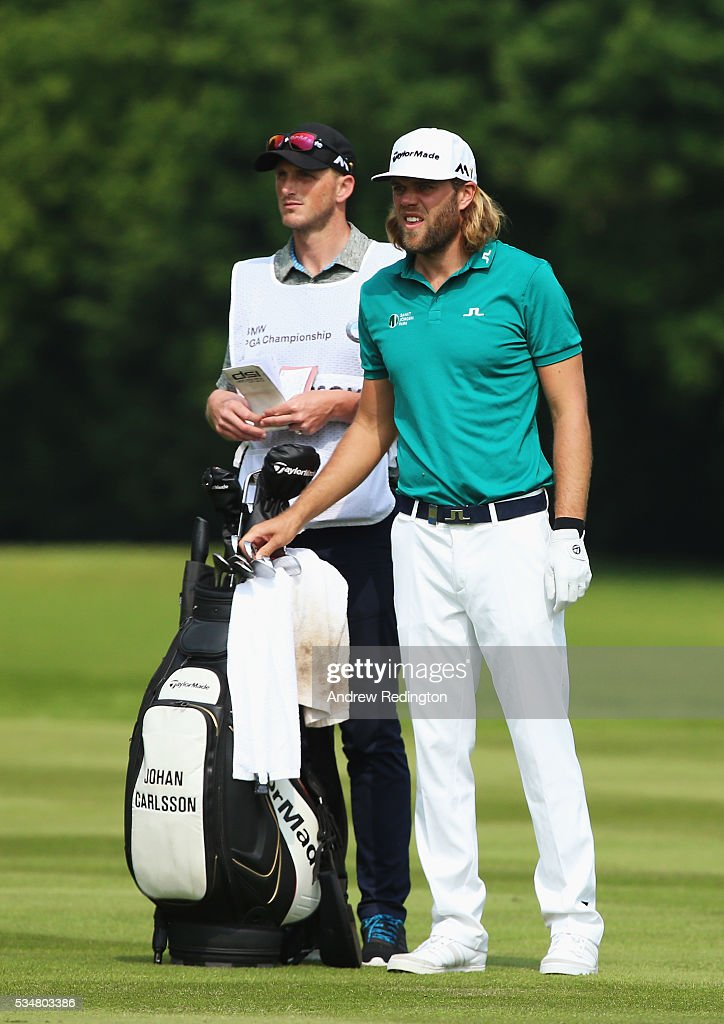 Johan Carlsson of Sweden looks on with his caddie on the 18th hole during day three of the BMW PGA Championship at Wentworth on May 28, 2016 in Virginia Water, England.