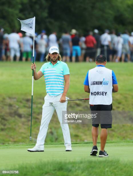 Johan Carlsson of Sweden tends the flag on the 4th green during day three of the Lyoness Open at Diamond Country Club on June 10 2017 in Atzenbrugg...