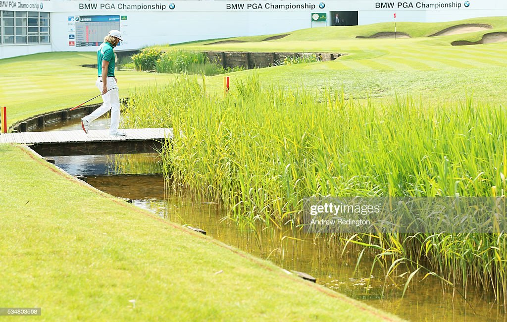 Johan Carlsson of Sweden walks across the bridge on the 18th hole during day three of the BMW PGA Championship at Wentworth on May 28, 2016 in Virginia Water, England.