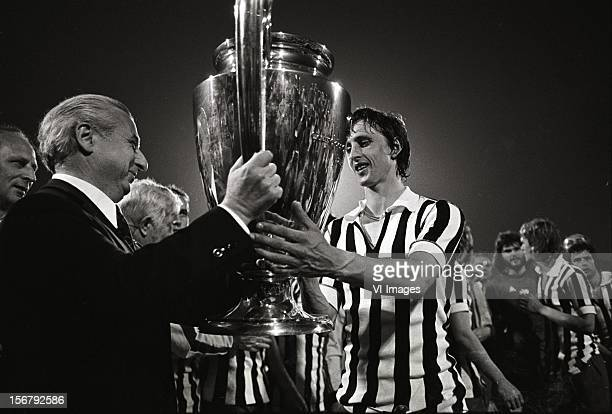 Johan Cruijff recieves the Cup after winning the European Cup final match between Ajax and Juventus at the Red Star Stadium on May 30 2012 in...