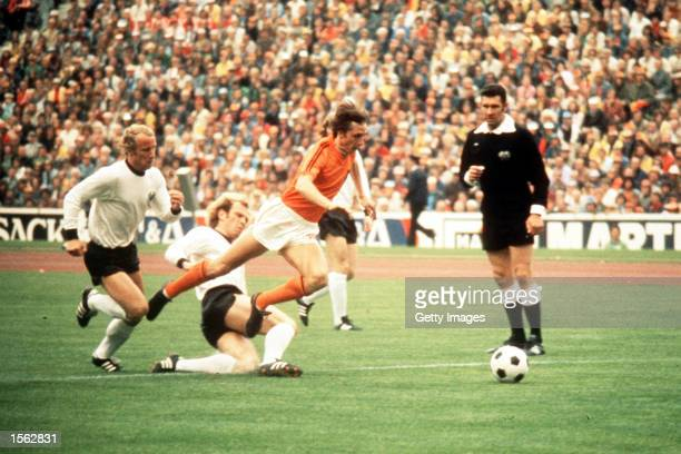 Johan Cruyff of Holland jumps a tackle from Uli Hoeness of West Germany during the 1974 World Cup Final Mandatory Credit Allsport UK